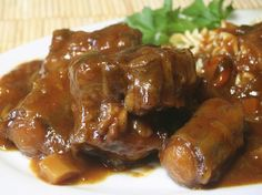 Oxtails are one of the most flavorful beef cuts. Long braising of oxtails makes the meat fall off the bones.