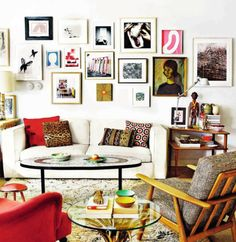 Taan says: Frames, printed cushions, bit of retro. Looks like a happy place :-)