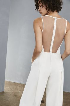 Sheer illusion back white bridal jumpsuit by Amsale with wide legs pockets v neck and buttons up the back Classic Wedding Dress, Chic Wedding, Wedding Dresses, Wedding White, White Bridal, Wedding Jumpsuit, Homecoming Jumpsuit, Little White Dresses, Custom Dresses