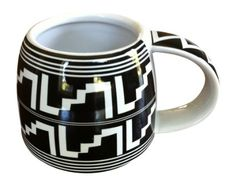 The Mesa Verde Cliff Dweller 12 Oz. Mug channels pottery history with a stair step pattern inspired by cliff-dwelling Mesa Verde (Anasazi) and Mimbres designs. Perfect for coffee, tea, and more!