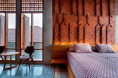 andyrahman architect brings elements of traditional indonesian architecture to 'omah boto' Arty Bedroom, Bedroom Red, Feature Wall Bedroom, Bedroom Wall Colors, Home Luxury, Magazine Design, Brick Architecture, Design Furniture, Interior Walls
