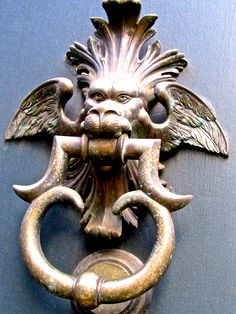 Roaming the streets of Milan when I came across this fascinating door knocker - love it! Milan, Italy