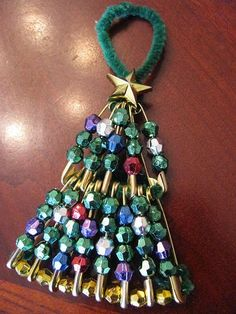 Safety pin Christmas tree ornament.
