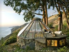 Mickey Muennig's architecture is a common sight throughout the unforgettable Big Sur landscape. He designed many of the most striking residences along this coastline including the Esalen Baths and the Post Ranch Inn. This 16 sq foot glass teepee is where he lived for about 18 years as he worked on his larger home as well as his multitude of client projects.