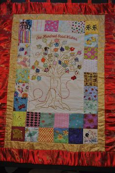 This is an awesome quilt designed for a little girl adopted from China.  It has the red thread Chinese saying on it too!  So sweet!