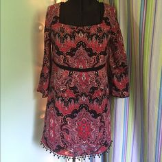 Free People patterned dress Never worn free people dress with bell sleeves and crochet detailing alone the collar, hemline. And sleeves. Ties in the back. Super cute but it is just too short on me :( Free People Dresses