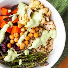Health and flavor in one bowl. Oven roasted veggies served over fluffy quinoa, drizzled with a killer creamy avocado sauce. Gluten Free