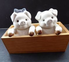 These are really sweet little piggies for your collection.  They date from the 1970s and were made in Taiwan by Fitz and Floyd - for the American…