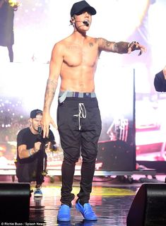 Oh Baby: Justin Bieber showed off his bulked up frame at a music festival in New York on Sunday