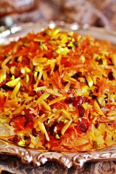 Shirin Polo is a glorious sweet Persian rice speckled with saffron and topped with golden carrots, raisins, slivered almonds, chopped pistachios and homemade candied citrus zest. This festive rice is usually served at the weddings, Nowruz and other special ceremonies