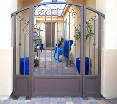 Courtyard Entry Gates - Artistic Iron Works - Ornamental Wrought Iron Specialists