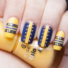 Hand placed glitter and studs on yellow