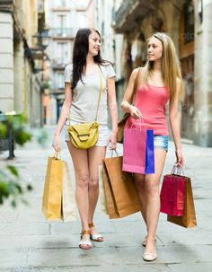 Two girls walking with shopping ...  20-30, american, bags, buying, casual, caucasian, city, cloth, clothing, consumerism, couple, customer, discount, european, fashion, female, friends, girls, happy, holding, leisure, lifestyle, long-haired, ordinary, outdoor, passion, people, person, positive, purchases, sales, satisfaction, shopaholic, shopper, shopping, shorts, smiling, souvenirs, street, tour, tourists, town, travel, two, vacation, weekend, white, women, young