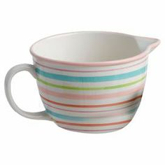"""Whip up chocolate chip cookies in bright style with this charming earthenware batter bowl, showcasing an easy-pour spout and multicolor stripes.  Product: BowlConstruction Material: EarthenwareColor: IvoryFeatures:  Spout for pouringHandled for easy carrying Dimensions: 5.5"""" H x 7"""" Diameter"""