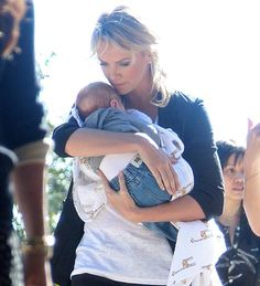 Charlize adopts a baby and spares him a ridiculous name. Mazel!