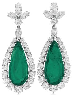 A PAIR OF EMERALD AND DIAMOND EAR PENDANTS, BY BVLGARI  Each suspending a pear-shaped emerald, within a graduated circular-cut diamond surround, to the marquise and circular-cut diamond quatrefoil surmount, mounted in platinum, 1960 By BVLGARI  $3,218,500.00