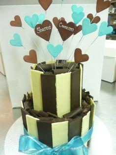Two tiered white chocolate and milk chocolate slat cake