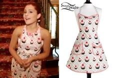 Outfit 2   Ariana Grande show off her house – video: youtube  Ariana Grande has a cute retro style even when she's cooking! During a video tour of her house, she steps into her kitchen and puts on a Jessie Steele Cupcakes Apron ($24.32).
