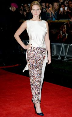 Jennifer Lawrence wears a silk white column gown with sequin detailing