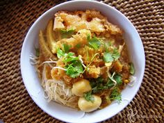 Mohinga - recipe This is the national dish of Burma. Check out the recipe. It' usually garnished with fresh coriander, boiled eggs, fried batter coated cucumber sticks, chilli paste, choped peanuts, spring onions etc. (it's not mentioned in the recipe).