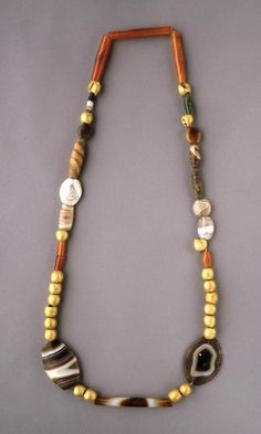 Jewelry from The Royal Tombs of Ur.  Necklace: Gold, carnelian, jasper, and marble. It looks very modern.