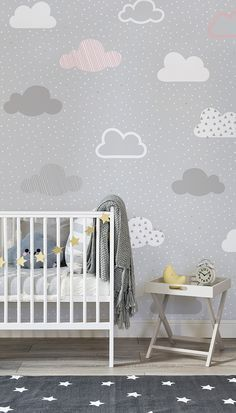 Effortlessly chic, this nursery space balances neutral greys with lively pops of golden yellow. Illustrated clouds drift along in this beautiful wallpaper design. It's a timeless pattern that will look just as stylish for years to come.
