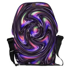 """Purple swirl messenger bag by Valxart.com $141.70 Water resistant, extra durable (machine-washable).  Large main compartment and 2 front pockets.  Form fitted to your body.  Quick-adjust cam shoulder strap.  Holds a 15"""" laptop (w/optional sleeve).  Made with a sustainability focus in San Francisco, CA.  Dimensions 12"""" H x 21"""" W x 9"""" D."""