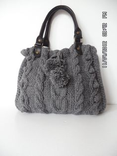 It has Leather Handles and a little double pocket inside shoulder bag. 100% Hand knitted with warm and soft yarns (wool&acrylic), good for use in winter, also in summer. Also a great bag for your macbook pro 133! Magnetic closure and satin lining Pompoms are removable, and you can