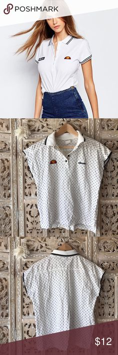 """Asos polka dot polo size M by Ellesse Asos polka dot polo size M by Ellesse. Excellent condition. Style is in between cap sleeve an sleeveless. Across chest about 20"""". Length about 24"""". Very good quality. 100% Cotton! Ellesse Tops"""