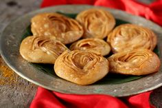 Chiroti recipe - a fried flaky pastry topped with powdered sugar or dipped in sugar syrup. Traditional Indian sweets prepared for festivals like Diwali.