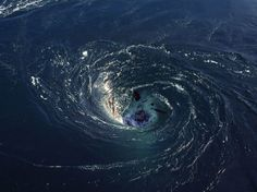 Satellites reveal two mysterious 'black hole' whirlpools in the South Atlantic ocean.