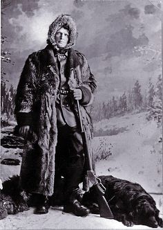 Dressed for hunting in the cold north country and accompanied by his Labrador Retriever, this late-19th- century sportsman has opted for Winchester's 1887 lever-action shotgun to make fast follow-up shots in his quest for feathered game.