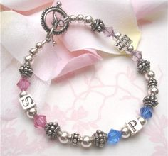 My Sweet Dreams Baby - The Anna Initial Grandmother's Bracelet (http://www.mysweetdreamsbaby.com/grandmothersbracelets/annainitial.htm)