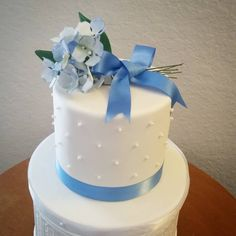 Anniversary Tier Simple dot pearl design with dusty blue ribbon and sugar hydrangea