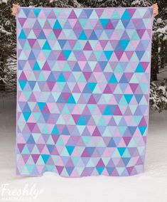Decompress while you make the Purple and Turquoise Triangle Quilt Pattern. Its beginner-level tutorial and easy breezy style make this free quilt pattern a guaranteed stress-reliever.