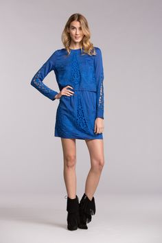 A little bit of lace goes a long way. An embroidered overlay lends intricate texture to this sophisticatedly sweet tunic dress while the buttoned keyhole in bac