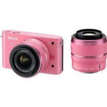 I shoot with a Canon and always been loyal to Canon but damn, I want to have this hot pink Nikon 1 J1 pretty bad!