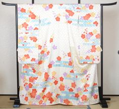 Plums and water pattern furisode (long-sleeved kimono).