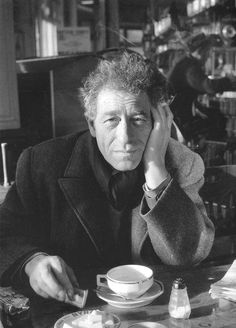 Robert Doisneau // Alberto Giacometti Swiss sculptor in the cafe, 1959 in Paris, France. ( http://www.gamma-rapho.com/fr/spotlight/202439/cafes-by-robert-doisneau/page/6/search/robert+doisneau