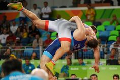 Sergey Semenov of Russia lifts Heiki Nabi of Estonia for points en route to winning bronze (810×540)