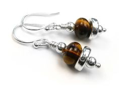 Sterling silver earwires with a sweet heart and Swarovski crystal in the colour of January's birthstone which is garnet. Tiger Eye Beads, Gemstone Earrings, Birthstones, Sterling Silver Jewelry, Garnet, Swarovski Crystals, Cufflinks, Ceramics, Gemstones