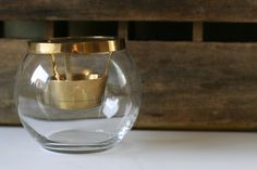 Mid Century Modern Brass and Glass Candle Holder. $12.00, via Etsy.