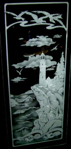 Etched glass window of ocean and lighthouse