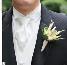 Jamie wore a boutonniere of ferns, astilbe, and green berries.
