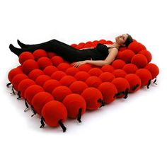 Molecular bed...the piece is made from interconnected softballs that can be arranged in a variety of different seating and lying positions.