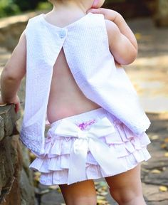 This light pink seersucker RuffleButt is an adorable addition to her spring and summer wardrobe! This diaper cover looks cute solo or layered under a dress. Shop Boys Seersucker Styles to coordinate!