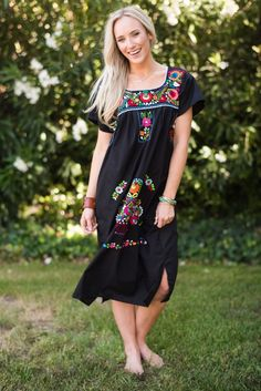 Traditional Mexican Dress handmade in Tehuacan Puebla. These dresses are made in soft cotton and carefully stitched and embroidered in colorful threads. The back of the dress also has beautiful embroi