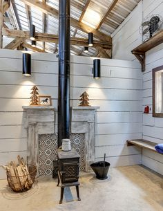 The ultimate goal was to create a non-traditional horse barn. The memorable blue hue and layout was carefully thought out. Horse Barn Plans, Horse Barns, Log Home Living, Living Room, Mechanical Room, Old Stove, Wood Fireplace, Fireplaces, Post And Beam