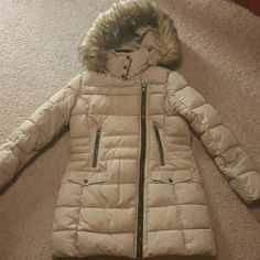 NWOT Steve Madden winter coat I've never been anywhere cold enough to wear this jacket. It's brand new without tags.    Asymmetrical front zip closure Two flap snap button closure pockets at front Two front zip closure pockets Removable zip hood Removable faux fur trim at hood Color - beige   Size small petite Steve Madden Jackets & Coats Puffers