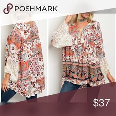AVAILABLE Stunning Lace Detail Rust Multi Tunic Long sleeve multi color and multi print tunic with a tassel neck tie and lace detailed sleeves. Tops Tunics
